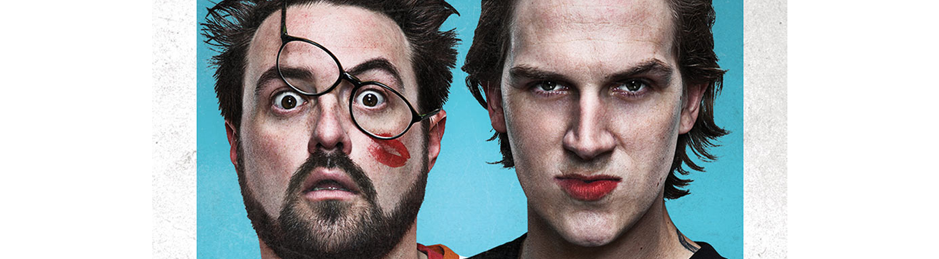 Photo of Jay and Silent Bob with glasses askew and lipstick mark on face