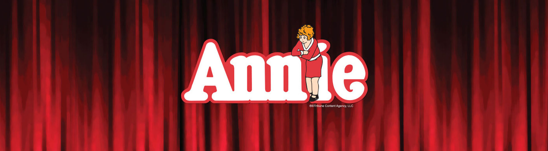 Annie title with cartoon Annie in front of letter i