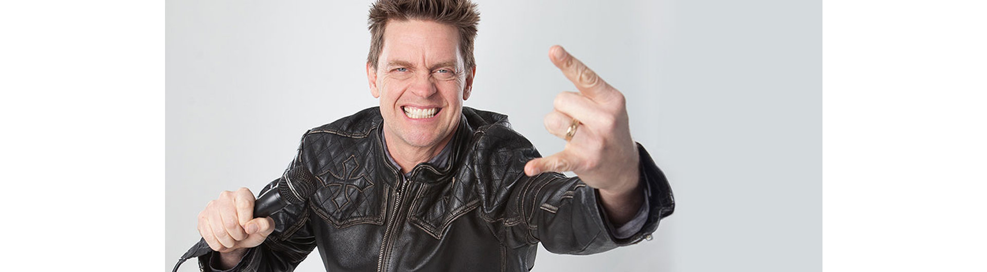 Photo of Jim Breuer with microphone in hand