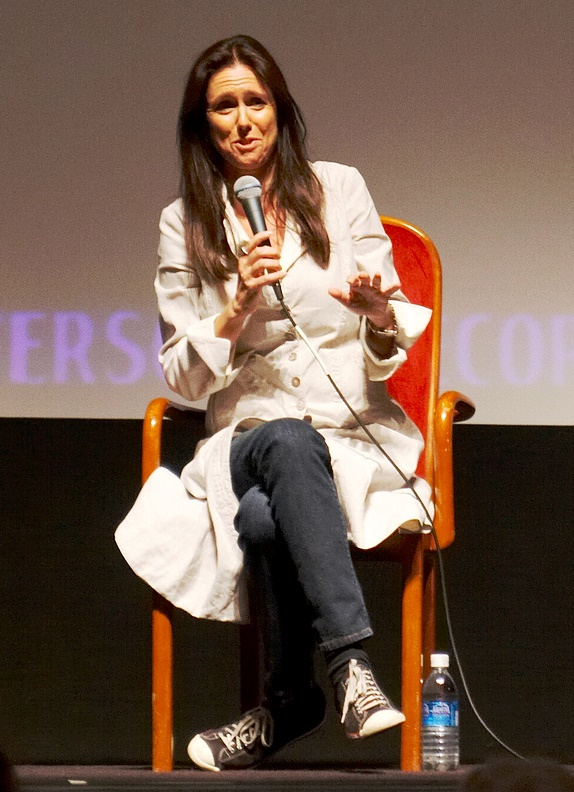 Photo of Julie Taymor seated speaking with microphone
