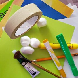 art supplies including colored paper, tape, paint, markers and more