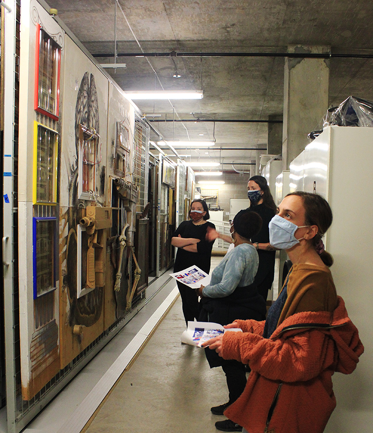 CC class looking at the art in the FAC collections storage area