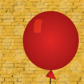 Red balloon on yellow brick background